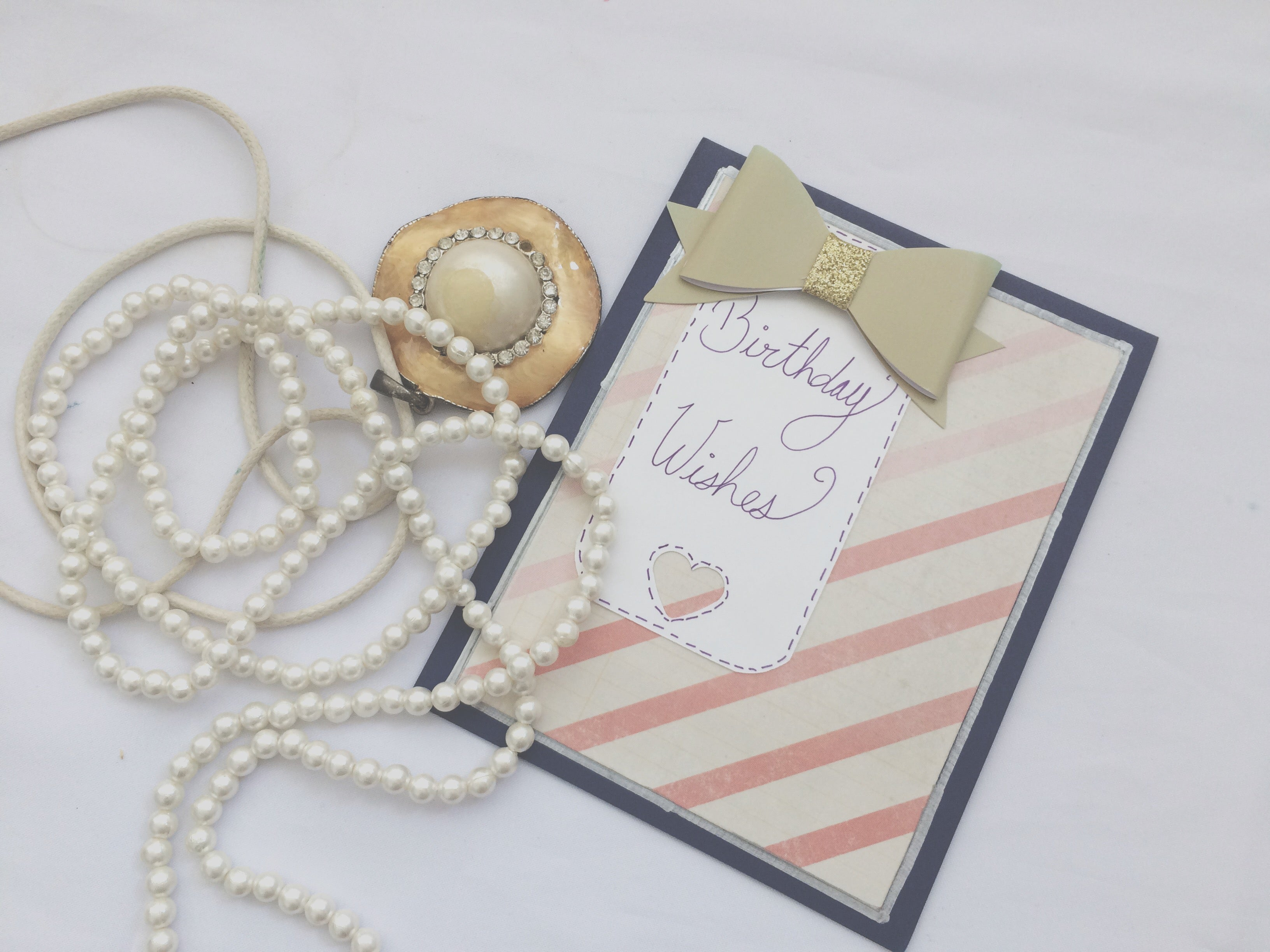 Royal Wish | Handmade Birthday Card | Navy background, pink striped pattern paper in middle, banner on let side with bow on top | Birthday Wishes sentiment on banner | Thoughtfully Handmade