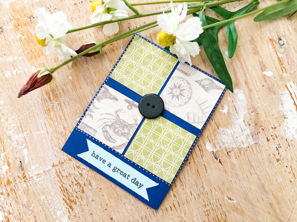Journey to Home | Handmade General Greeting Card | green & sea-themed pattern paper squares with button in middle | have a great day sentiment on light blue banner at bottom | Thoughtfully Handmade