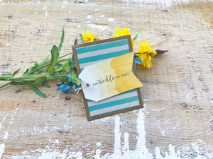 Sly Flirtations | teal and cream striped background with golden yellow tag, you tickle my fancy sentiment | handmade Valentine's Day card | Thoughtfully Handmade