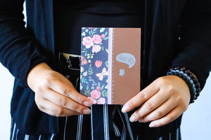Thankful For You | handmade thank you card | dark brown cardbase with panel of navy and pink floral paper on left side, strip of pastel pink washi tape over the seam and silver faux-stitch lines next to it | bird tweeting thank you sentiment | Thoughtfully Handmade
