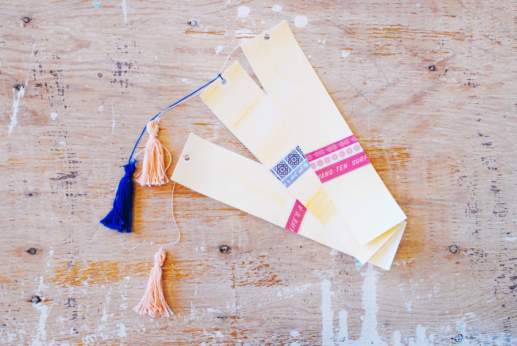 Watercolour Madness | Orange & Pink/Blue Variant | Handmade Watercolour Bookmarks | orange watercolour background with various designs on it | Navy or coral tassels | Thoughtfully Handmade
