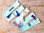 Watercolour Madness | Green Variant | Handmade Watercolour Bookmarks | green watercolour background with various designs on it | Navy or white tassels |  Thoughtfully Handmade