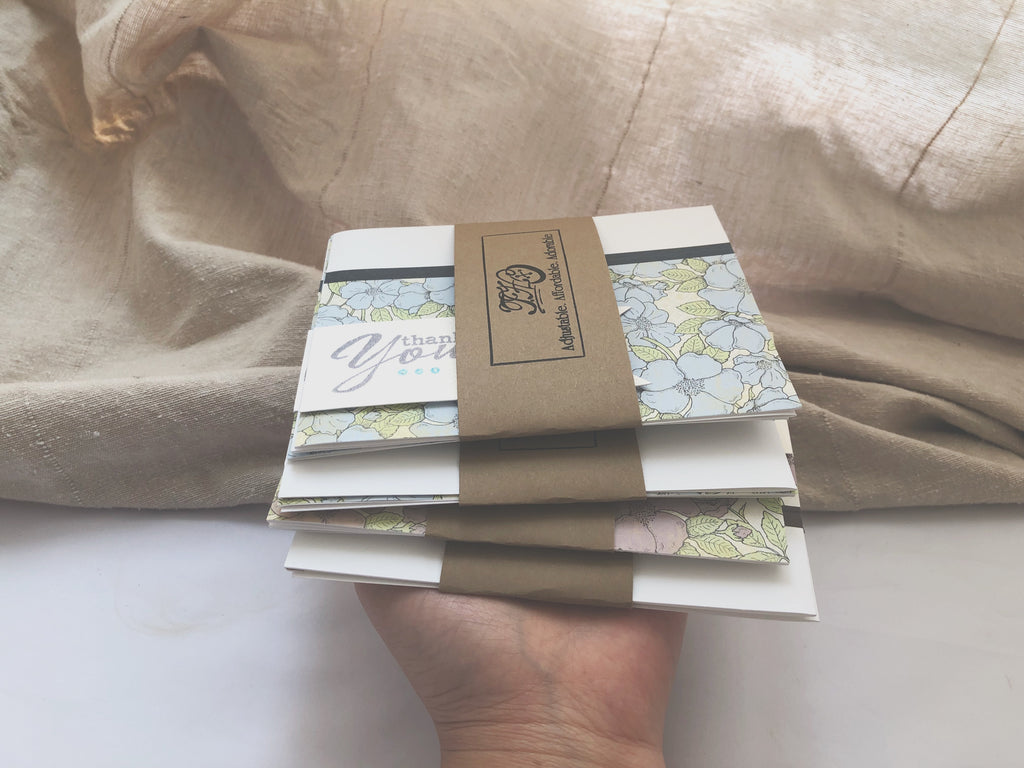 hand holding stack of Wist handmade thank you card set | Thoughtfully Handmade