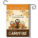 "With fall tones this illustration of turkeys with the saying ""We're Giving Thanks Around The Campfire""."