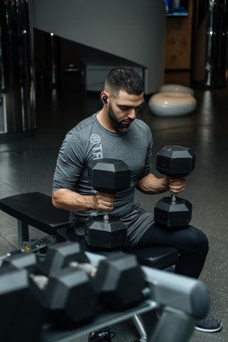 athlete working with dumbbells