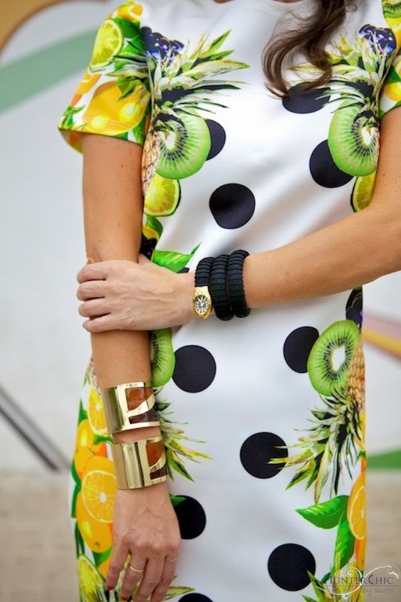 woman wearing black and gold serpent watch with bracelets
