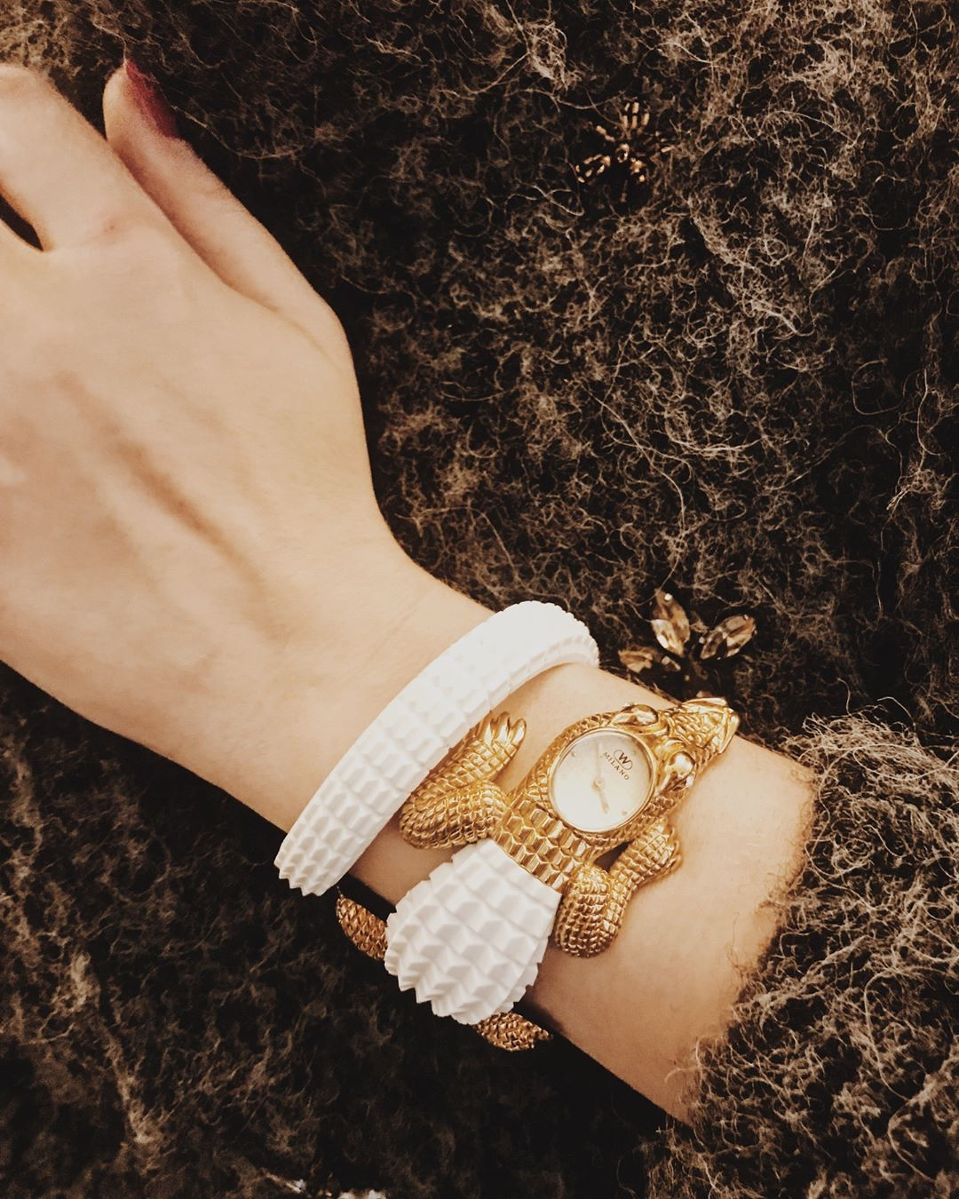 woman wearing white and gold crocodile watch