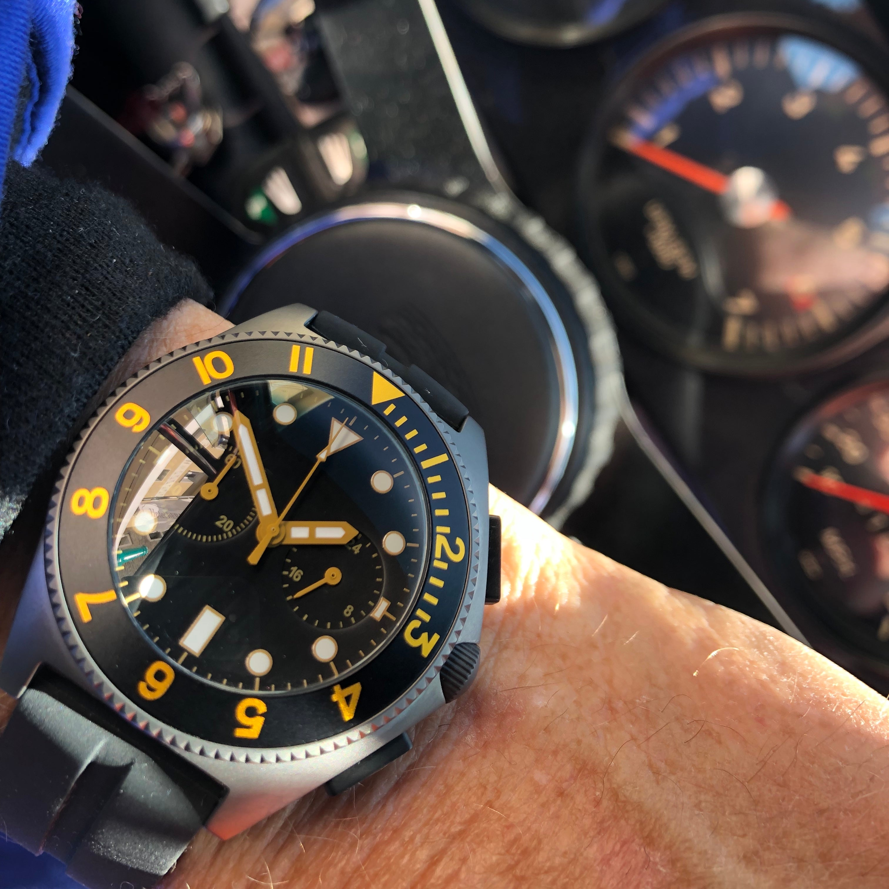 man wearing black and yellow watch