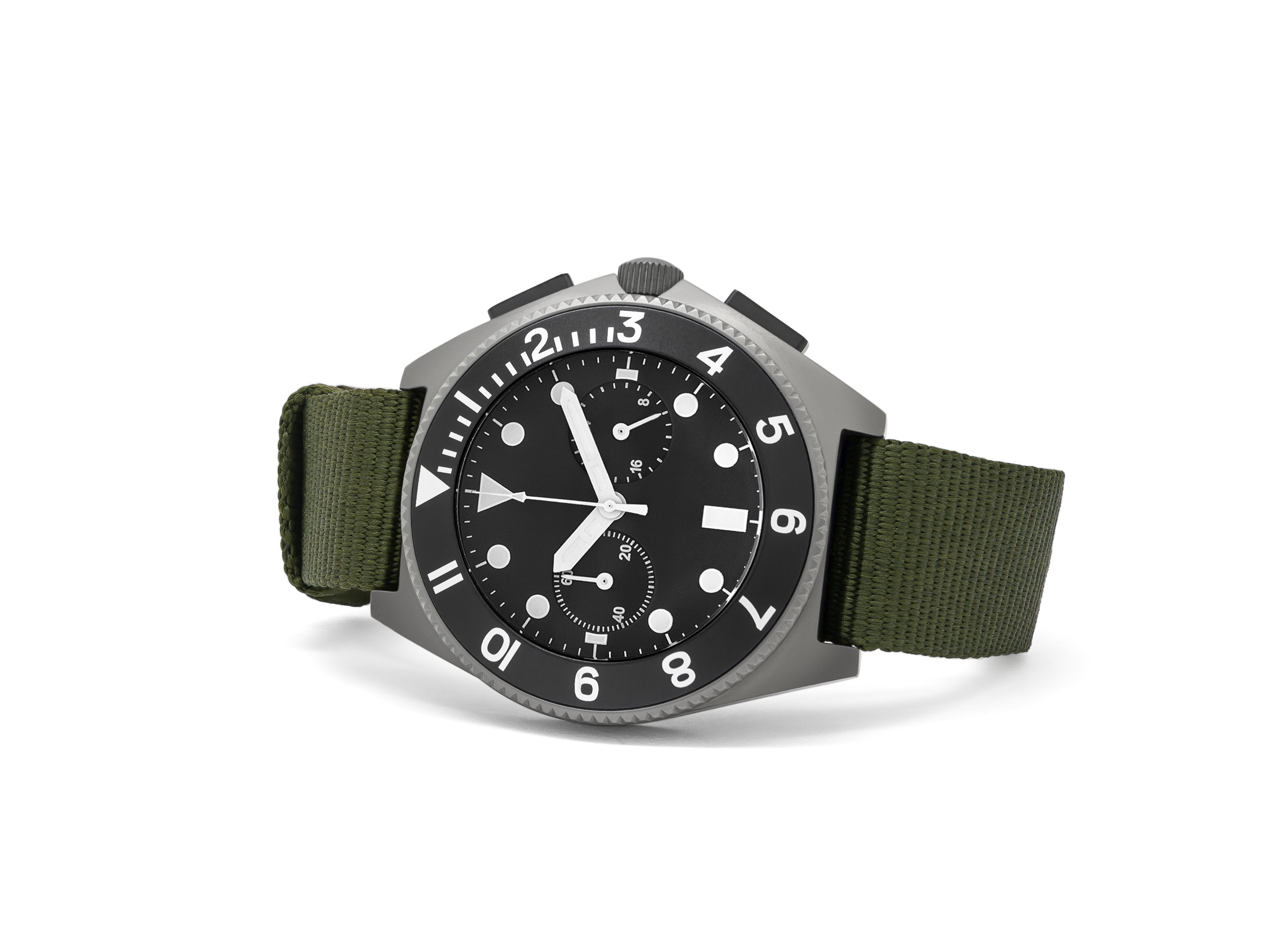 mens grey watch with green band resting on its side