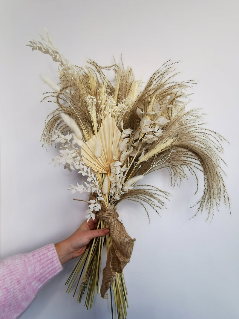 Ivory Palm and fluffy reed grass arrangement |