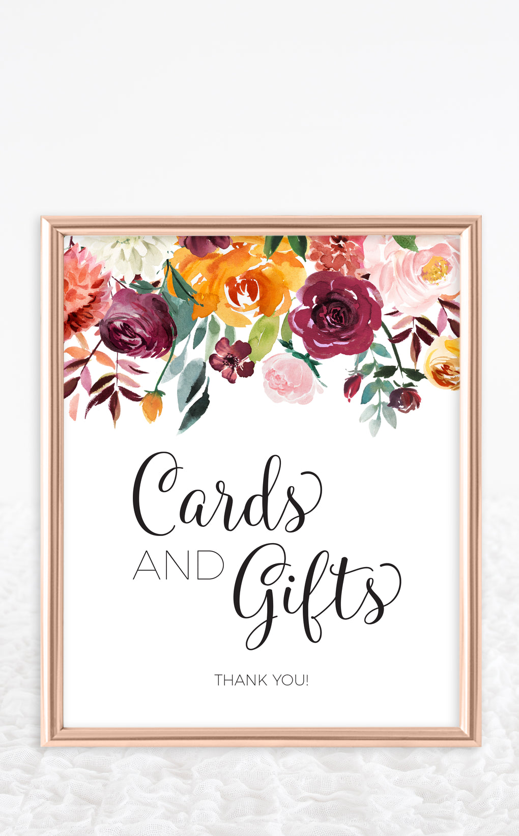 Burgundy floral cards and gifts sign on display at bridal shower