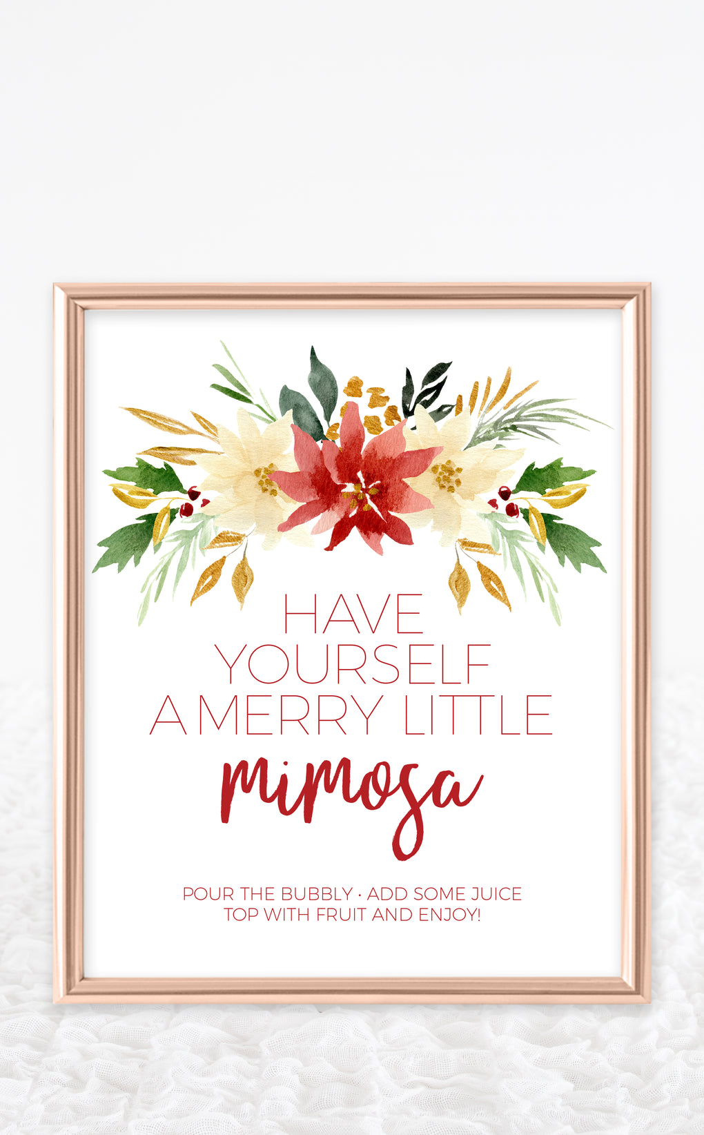 Christmas mimosa bar sign with red and white poinsettia bouquet