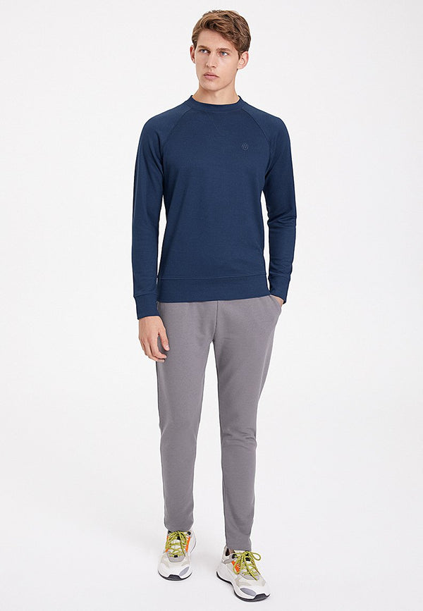 ESSENTIALS REGLAN SLEEVE SWEAT in Dress Blues