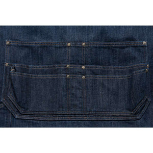 close up of lower pockets on Carhartt denim apron