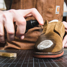 Otter Wax suede cleaner being sprayed onto suede shoe