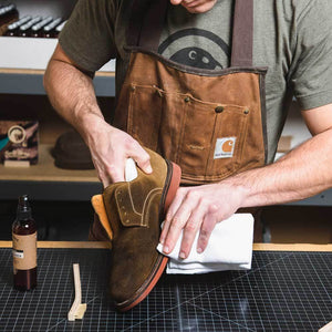 Otter Wax suede cleaner being wiped off shoe