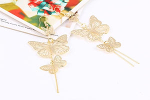 The Dancers -- Long Butterfly Dangle Earrings in gold