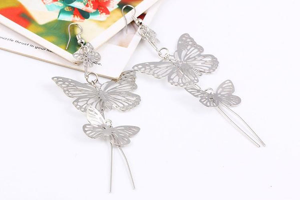 The Dancers -- Long Butterfly Dangle Earrings in silver