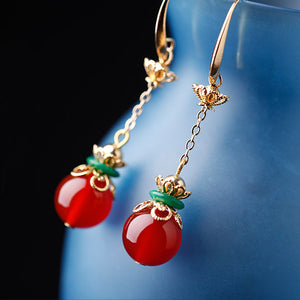 Asian earrings design, with red agate and green jade decorations