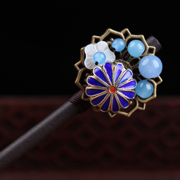 close up on the blue agate and enamel cloisonne flower