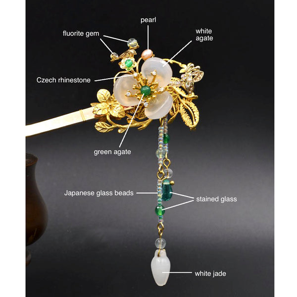 this hair stick is made of white agate, green agate, stained glass beads, freshwater pearls and 24K gold plating