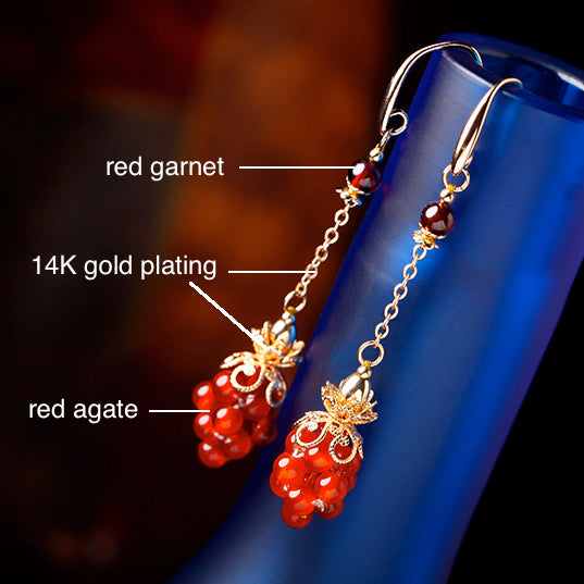 The earrings is made of red garnet, red agate and copper alloy plated with 14K gold