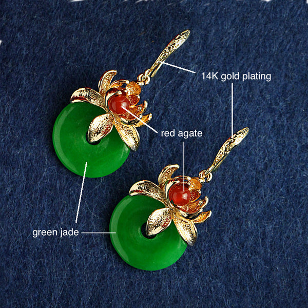 details of the earrings: it is made of green jade, red agate, and 14K gold plated metal parts