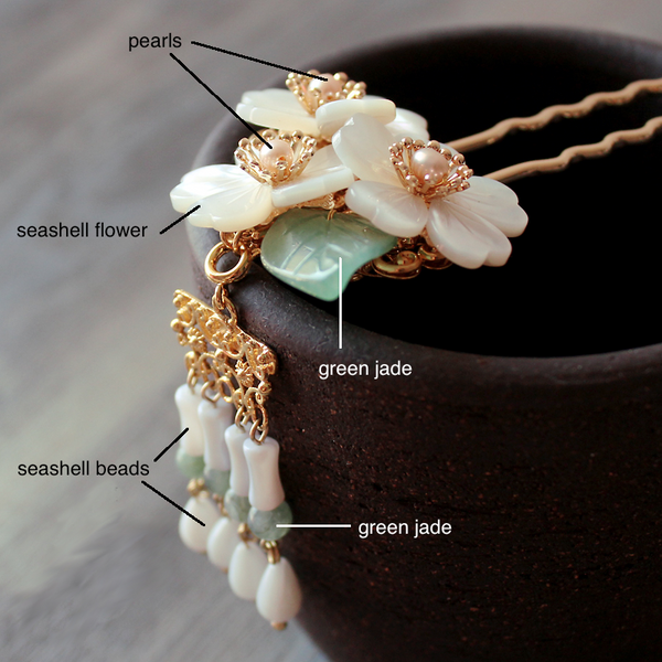 details of the hairpin. It is made of green jade, seashell and freshwater pearls.