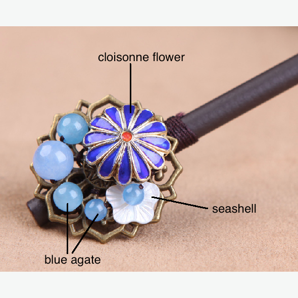details of the hair stick: it is made of blue agate stone, seashell, enamel cloisonne and wood