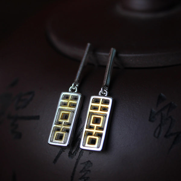 the Chinese characters are plated with 18K gold