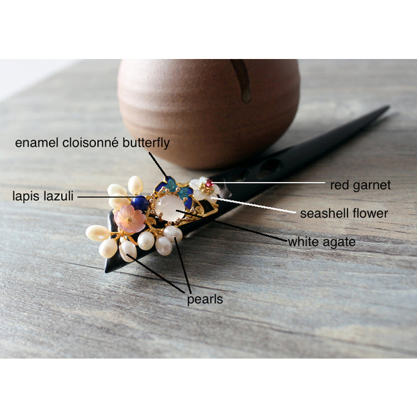 details of the hair stick. It is made of wood, enamel cloisonne butterfly, agate, lapis lazui, pearls, red garnet, etc.
