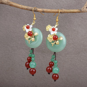 jade and flower dangle earrings with tassels