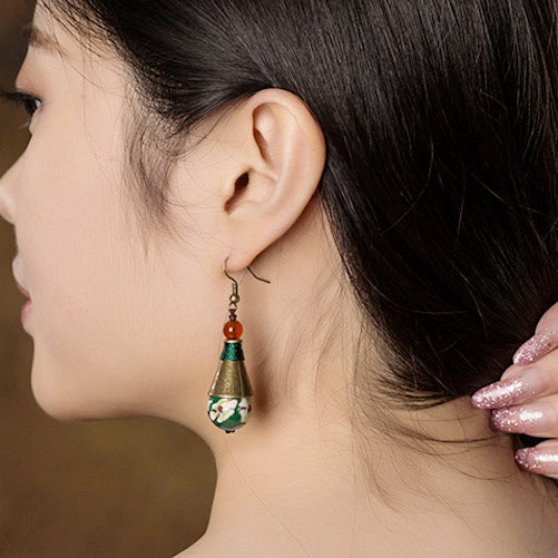 model wearing the earrings, side view
