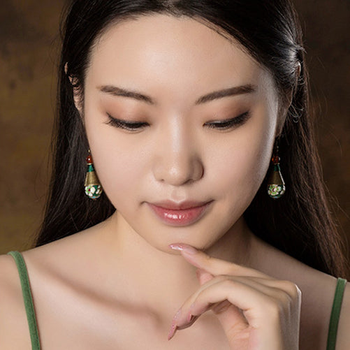 model wearing the earrings, front view