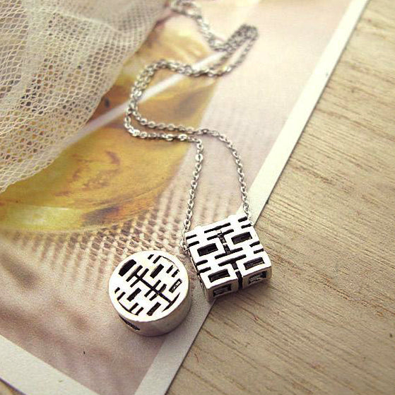 two styles of double happiness pendants together: square and round