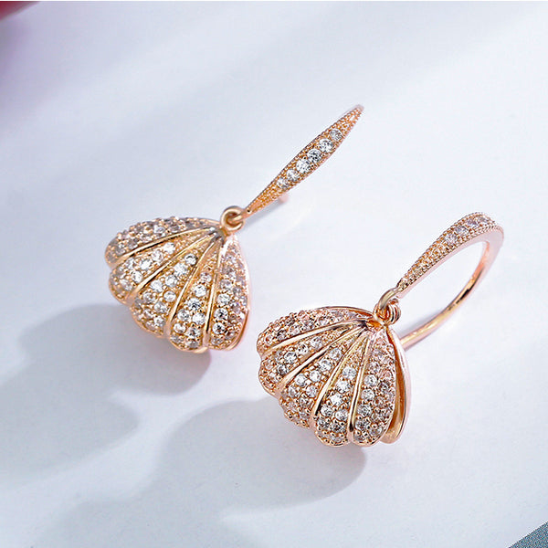 women's fashion earrings in shape of lovely seashell