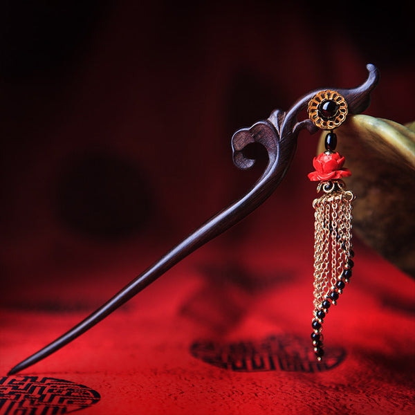 Wooden hair stick in Oriental style, decorated with gold plated tassels and black agate beads