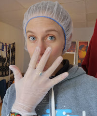 using nitrile or vinyl gloves and a hair net for at-home baking