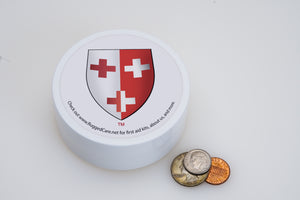 ultra-lite first aid kit case next to coins for size comparison