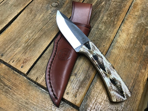 Snake skin design knife with leather sheath