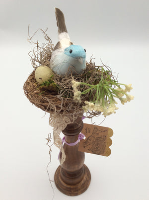 Bird in a Nest on Natural Stained Stand