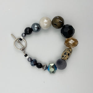 Black Beads with Metal Center Bead Bracelet