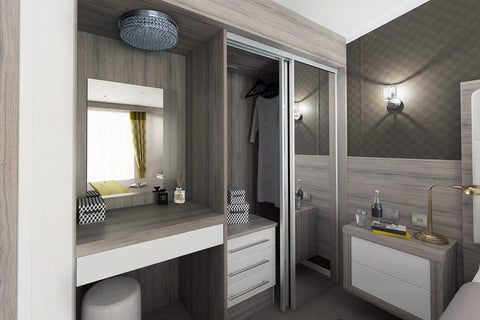 Sliding Wardrobes in a cabin lodge master bedroom