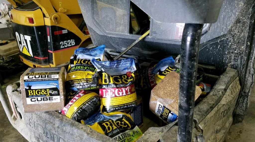 Tractor Bucket full of attractant and minerals