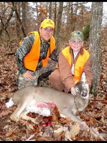 Father and Son with a deer.