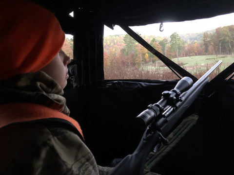 Youth hunting from a blind