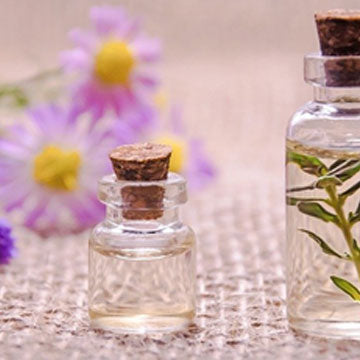 Glass bottles with flowers build the glass bottles