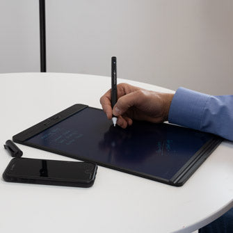 Side view man using Carbon Copy Smart Pen at table