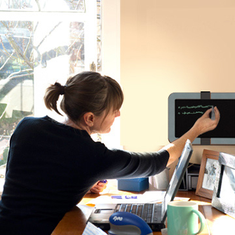Woman writing on Dashboard mounted in office