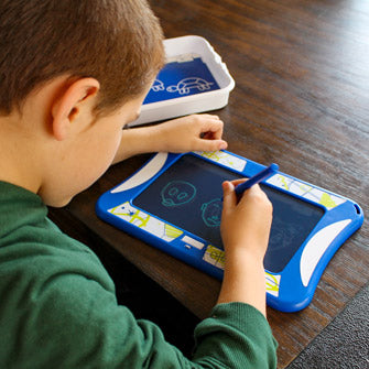 Child using Sketch Studio Kids Drawing Kit at Table overhead view